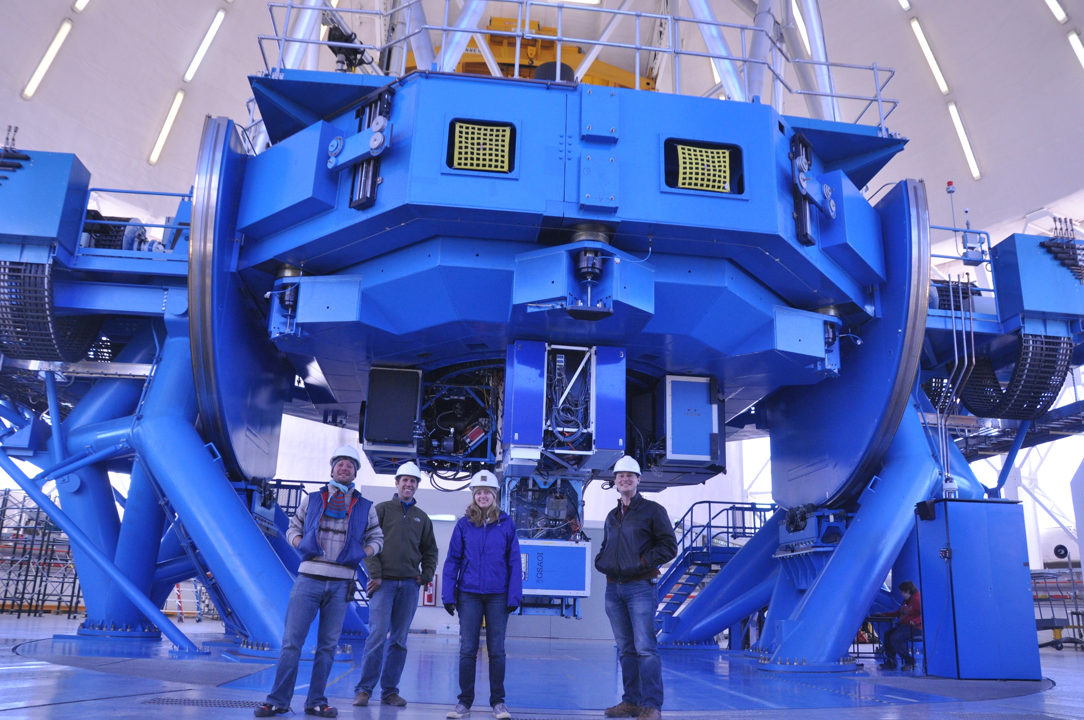 Some of the members of the GPI team in front of the Cassegrain focus of the Gemini South Telescope equipped with the GPI instrument. (credit: M. Perrin)