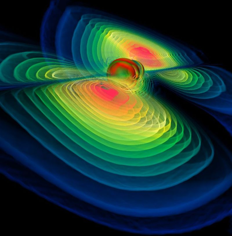 Computer simulation of a black hole collision. When two black holes merge into one, enormous amounts of energy are released in the form of gravitational waves.