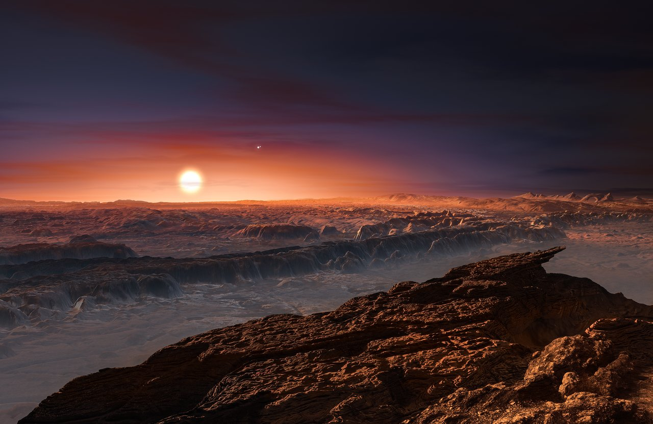 This artist's impression shows a view of the surface of the planet Proxima b orbiting the red dwarf star Proxima Centauri, the closest star to the Solar System. The double star Alpha Centauri AB also appears in the image to the upper-right of Proxima itself. Proxima b is a little more massive than the Earth and orbits in the habitable zone around Proxima Centauri, where the temperature is suitable for liquid water to exist on its surface. Credit: ESO/M. Kornmesser