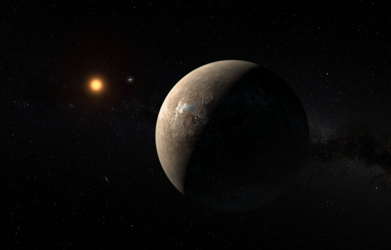 This artist's impression shows the planet Proxima b orbiting the red dwarf star Proxima Centauri, the closest star to the Solar System. The double star Alpha Centauri AB also appears in the image between the planet and Proxima itself. Proxima b is a little more massive than the Earth and orbits in the habitable zone around Proxima Centauri, where the temperature is suitable for liquid water to exist on its surface. Credit: ESO/M. Kornmesser