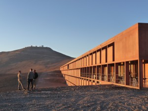 Joel, Paolo & Paolo and the residencia. In the background to top of Cerro Paranal and the VLT.