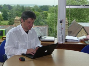 Working at the Denys Wilkinson Building, with a nice view on the park of the University of Oxford.