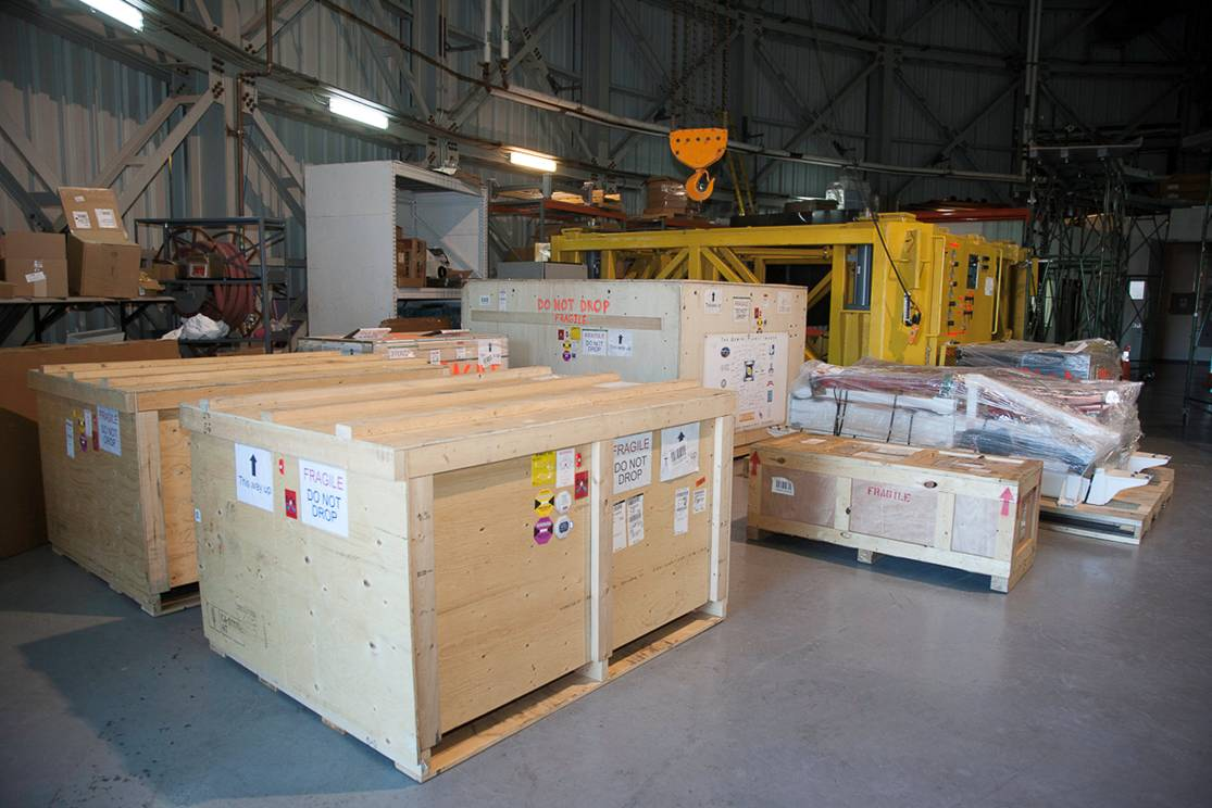 The crates are unloaded in the storage area of the Gemini South telescope (credit: Stephen Goodsell and Gaston Gausachs)