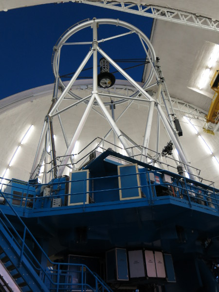 The Gemini South Telescope with the dome lights on.