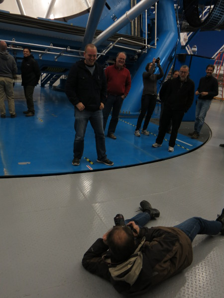 Markus sprawling out to get a nice shot of Lee, a journalist visiting us, and the telescope mirror.