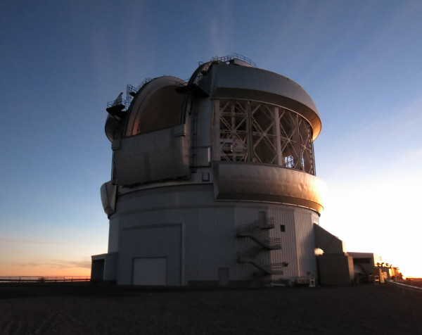 The telescope dome open at sunset .
